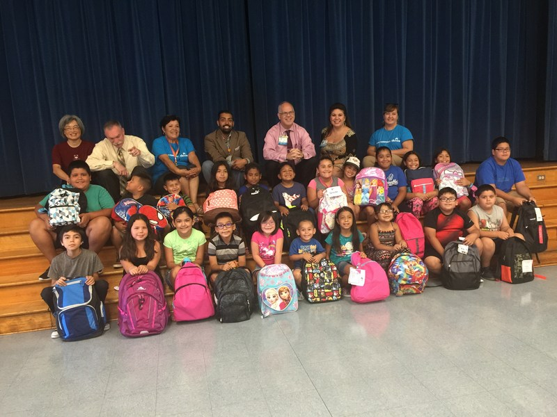 Students at Baldwin Park Unified's Vineland Elementary School stand with their backpacks on Aug. 10. The packs, loaded with school supplies and including such designs as flying hamburgers, Star Wars and Disney princesses, are among 300 donated to students through a partnership between the District and Kaiser Permanente Baldwin Park Medical Center.
