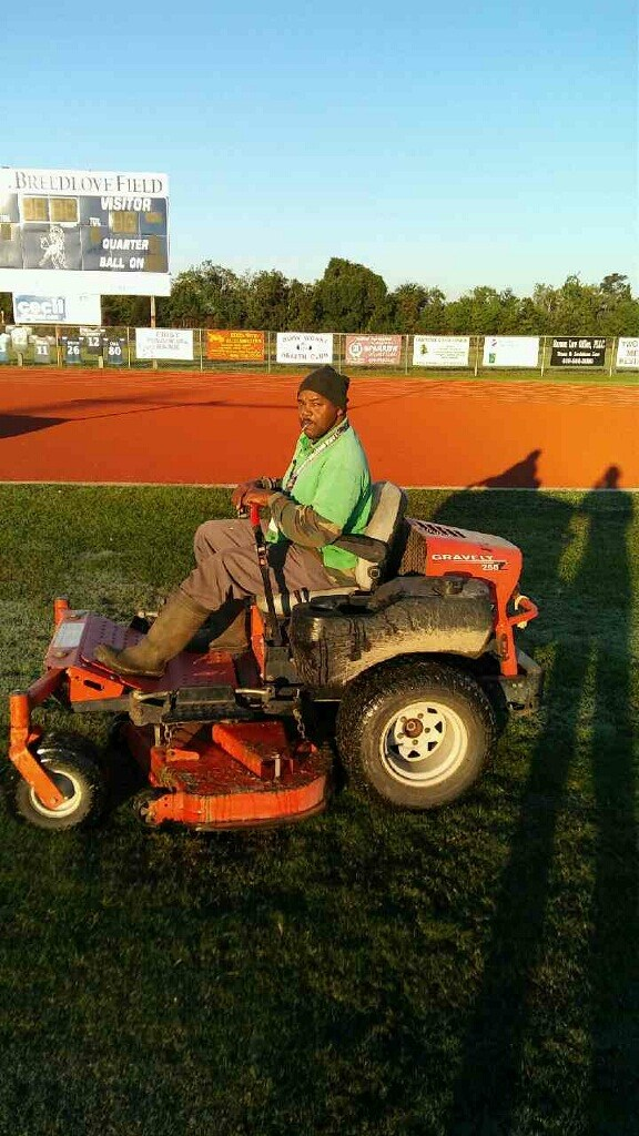 Groundsman mowing the middle school.