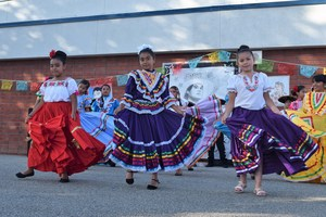 Dual-language students from Tracy Elementary wear traditional and contemporary Mexican attire as they demonstrate their fluency in English and Spanish by highlighting the life and works of Juan Gabriel on May 12.