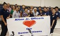 junior officers and Alton senior citizens holding feast of joy banner