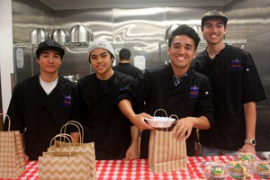 students pack lunches for staff