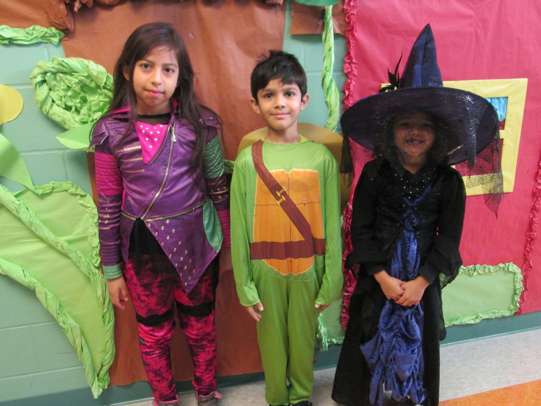 kids proudly wearing their costumes