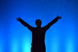 Man standing outside under stars.