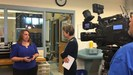 GMS teacher DeeAnn Moore talking with Fox 4 news about medical detectives class.