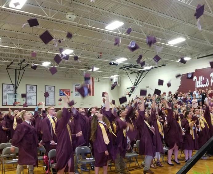 Graduates throwing caps at graduation.