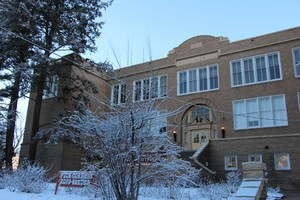Image of the Administration Building in winter and covered in snow.
