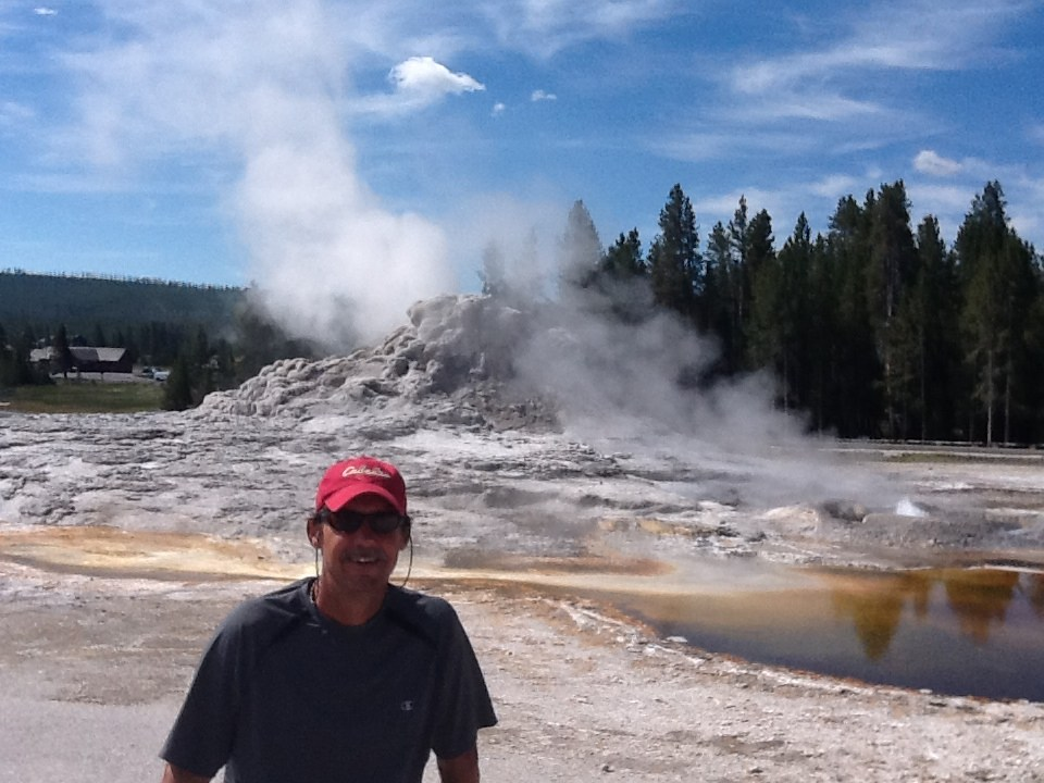 In front of a geyser at Yellowstone National Park