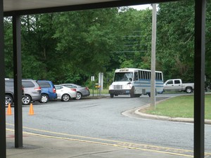 Bus with graduates pulls up to Pilot Elementary.