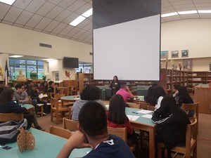 Students listening to a presenter from St. Edward's University.