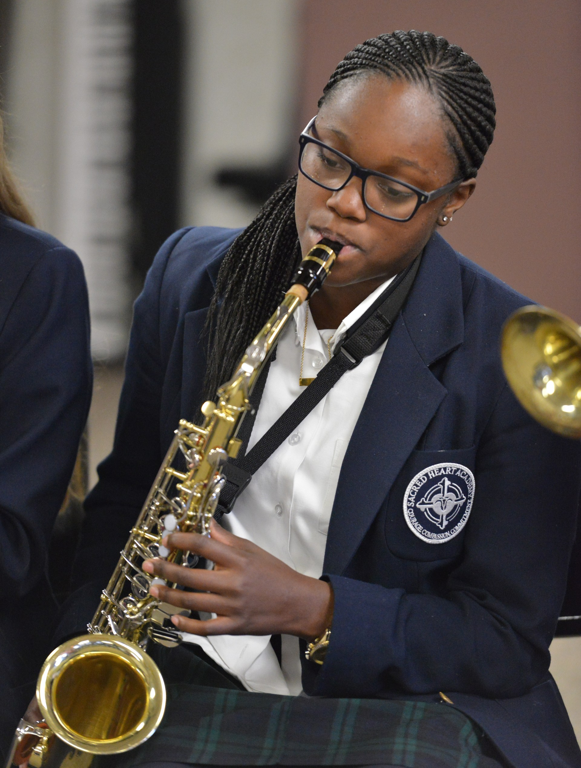 SHA student playing saxophone