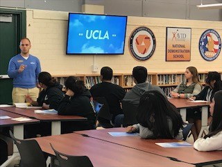 UCLA representative speaking to students in the media center