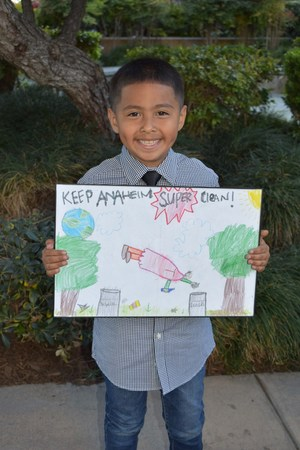 Elias Leon III Holds his Winning Poster