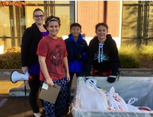student leaders collecting food donations