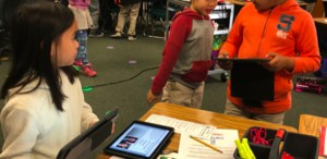 kids interacting with iPads