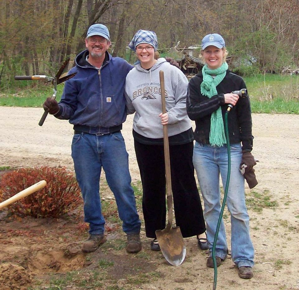 My dad, sister and I working in the yard.
