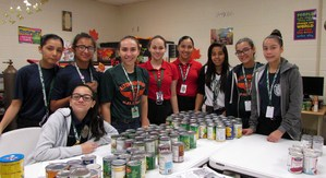 Junior officers sort canned foods for meals