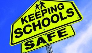 Blue background with yellow school safety sign