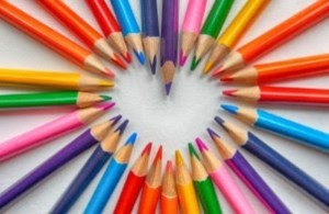 Array of colored pencils in the shape of a heart