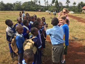 Kenyan kids receiving soccer balls