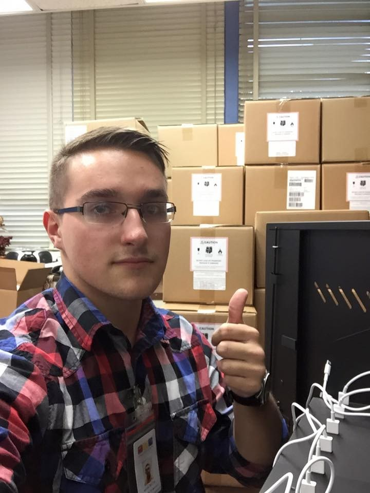 Technology employee, Aaron, giving a 'thumbs up' to the iPads