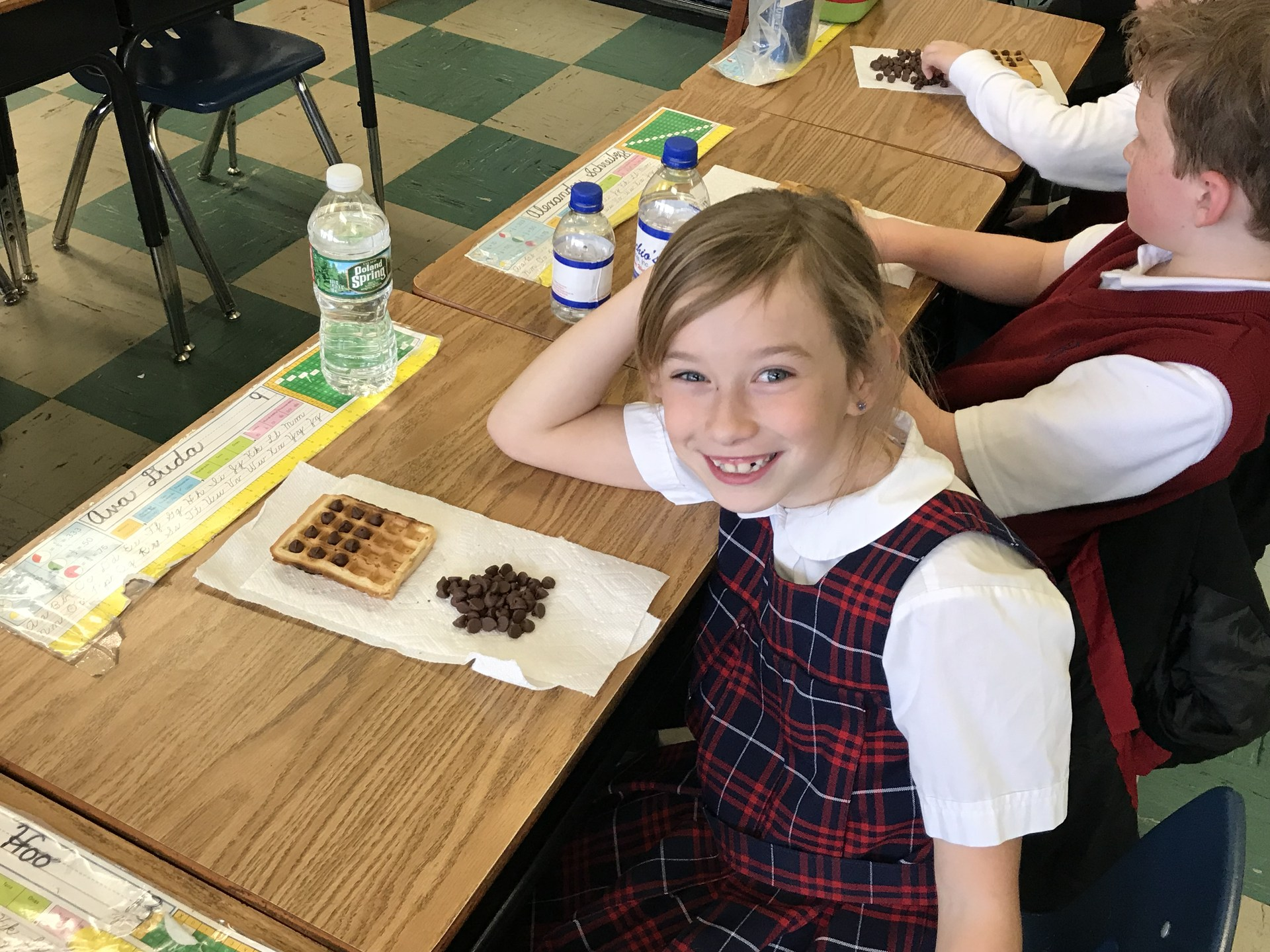 Student smiling after learning math lesson