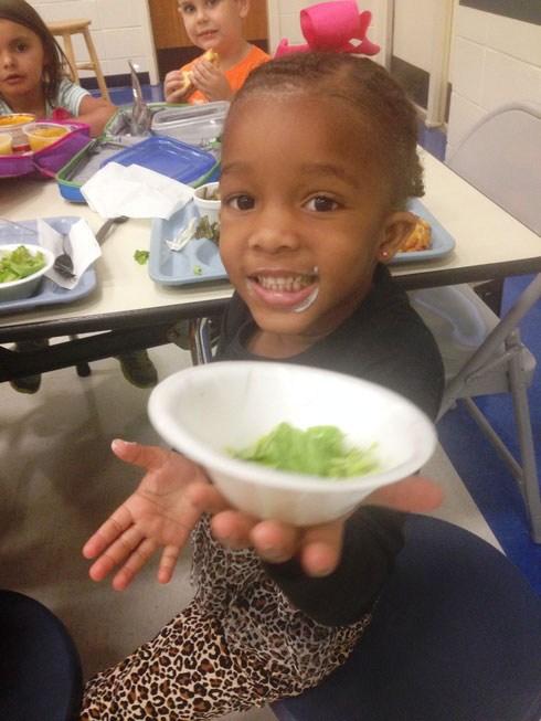 Little boy showing us his fruit bowl.