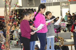 Students reading at the Camas Grandparent's Day