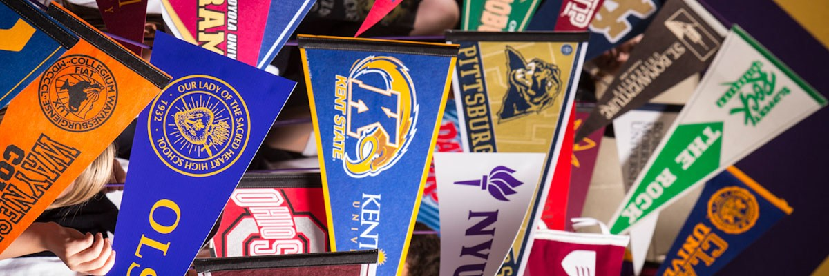 College pennants representing the wide range of schools attended by OLSH graduates