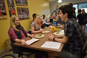 Students sitting at table eating