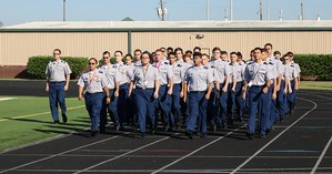 JROTC cadets marching down stadium track