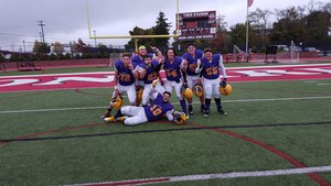 Football players pose together after winning the section championship