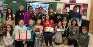 Jen Peabody with her 5th grade students.jpeg
