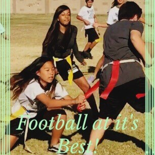 Girls playing flag football in middle school pe class