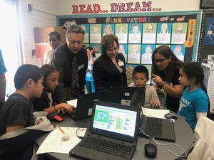 Mr. Cruz and Mrs. Yahya Learn about Coding