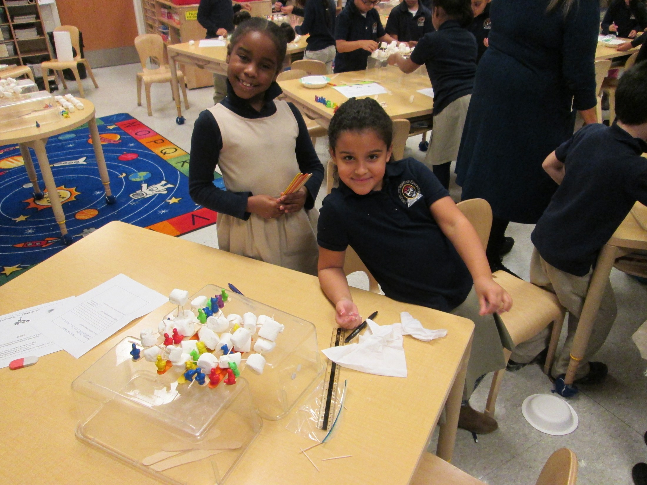 group working with sugar cubes