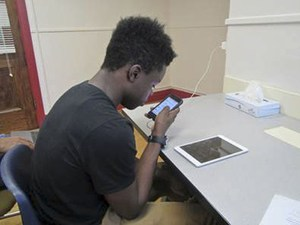 Student using iPad and iPhone
