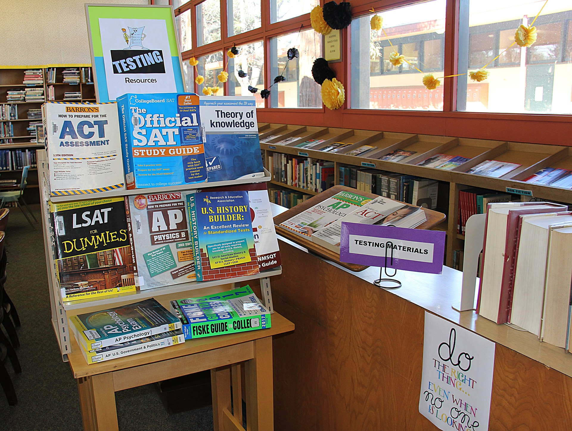 Image of books on Library shelf and easel