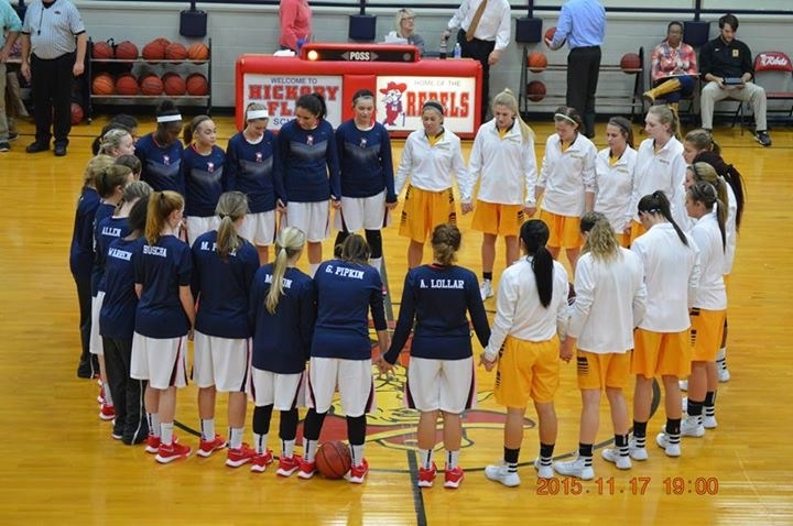 Girls basketball players in a circle