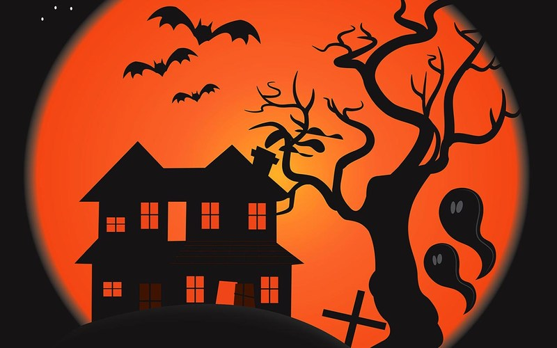 Halloween silhouettes, house bats, trees and ghosts on an orange moon background