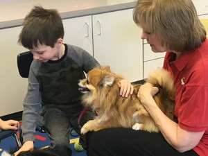 Student reads to dog