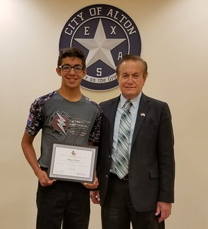 Cristian Navarro accepts an award from Alton Mayor
