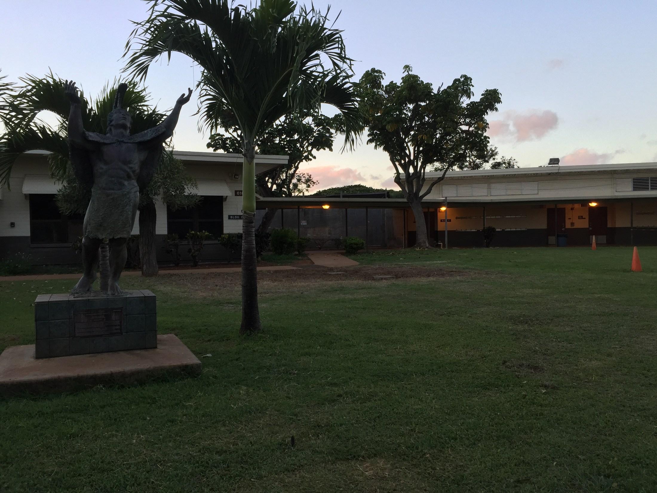 Statue fronting school