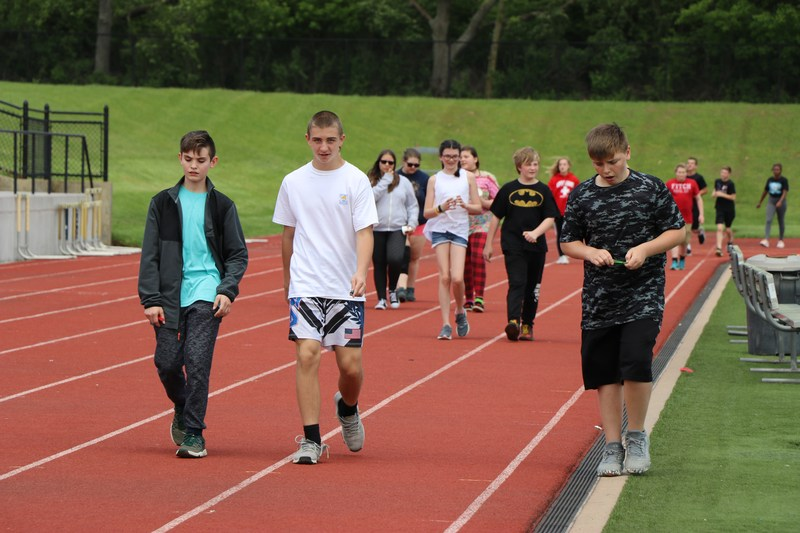 Students walk around the track.