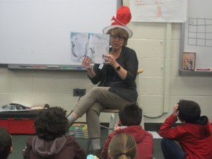 Dr. Hall reads a Dr. Seuss book to students.