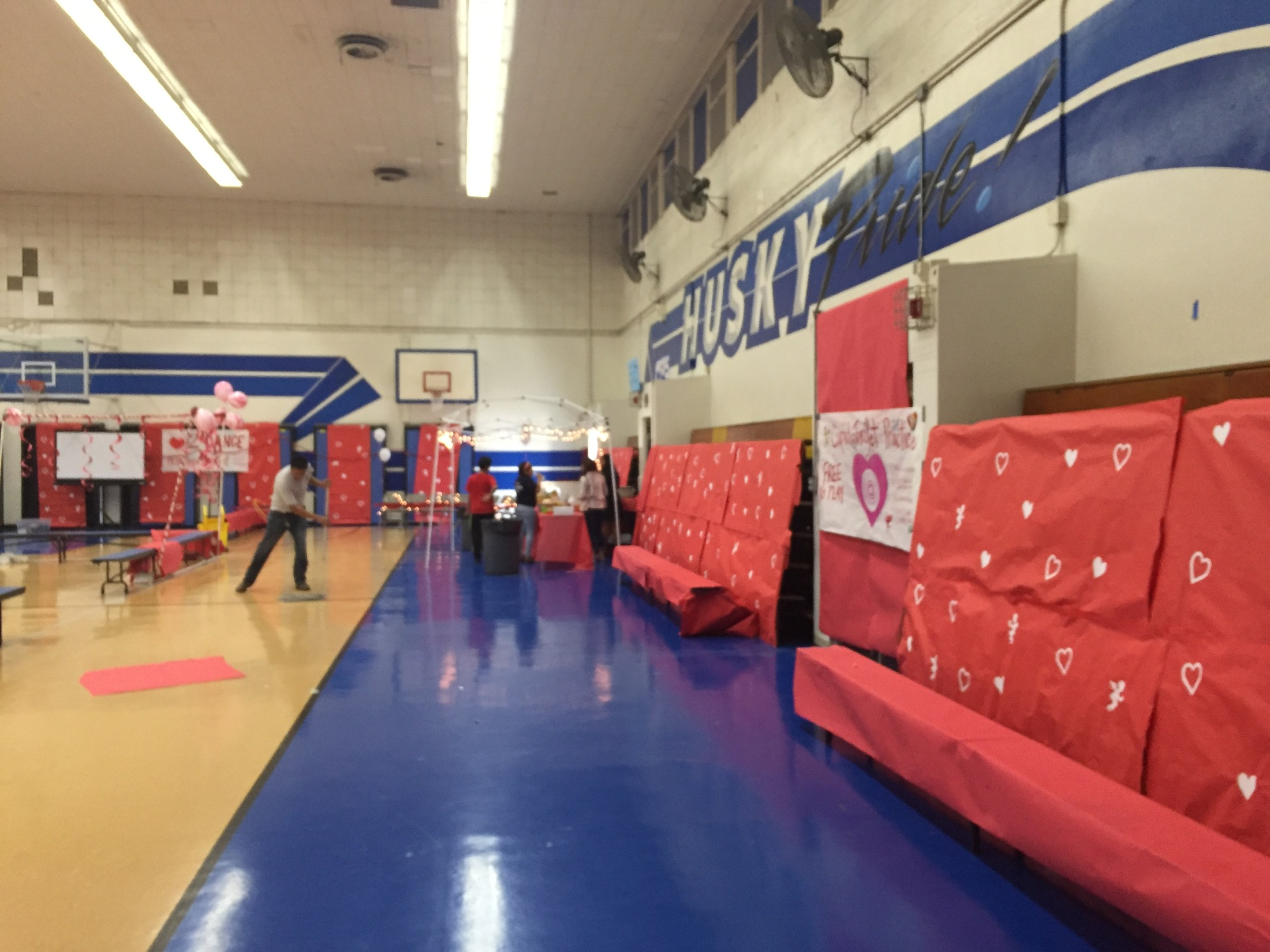 Setting up the gym for a Valentine's Day event