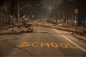 Street saying school in burned out neighborhood.