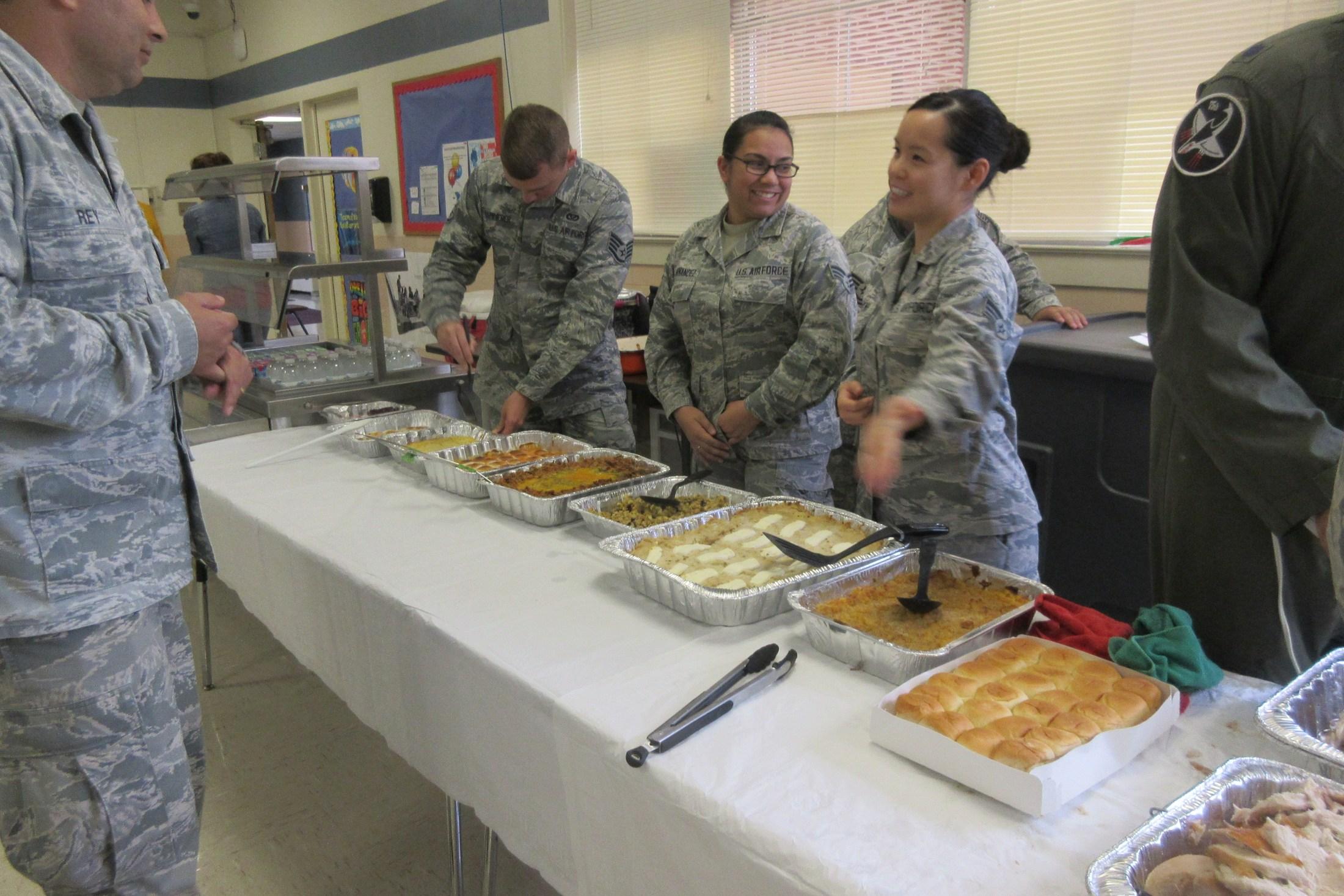 Airmen serving students