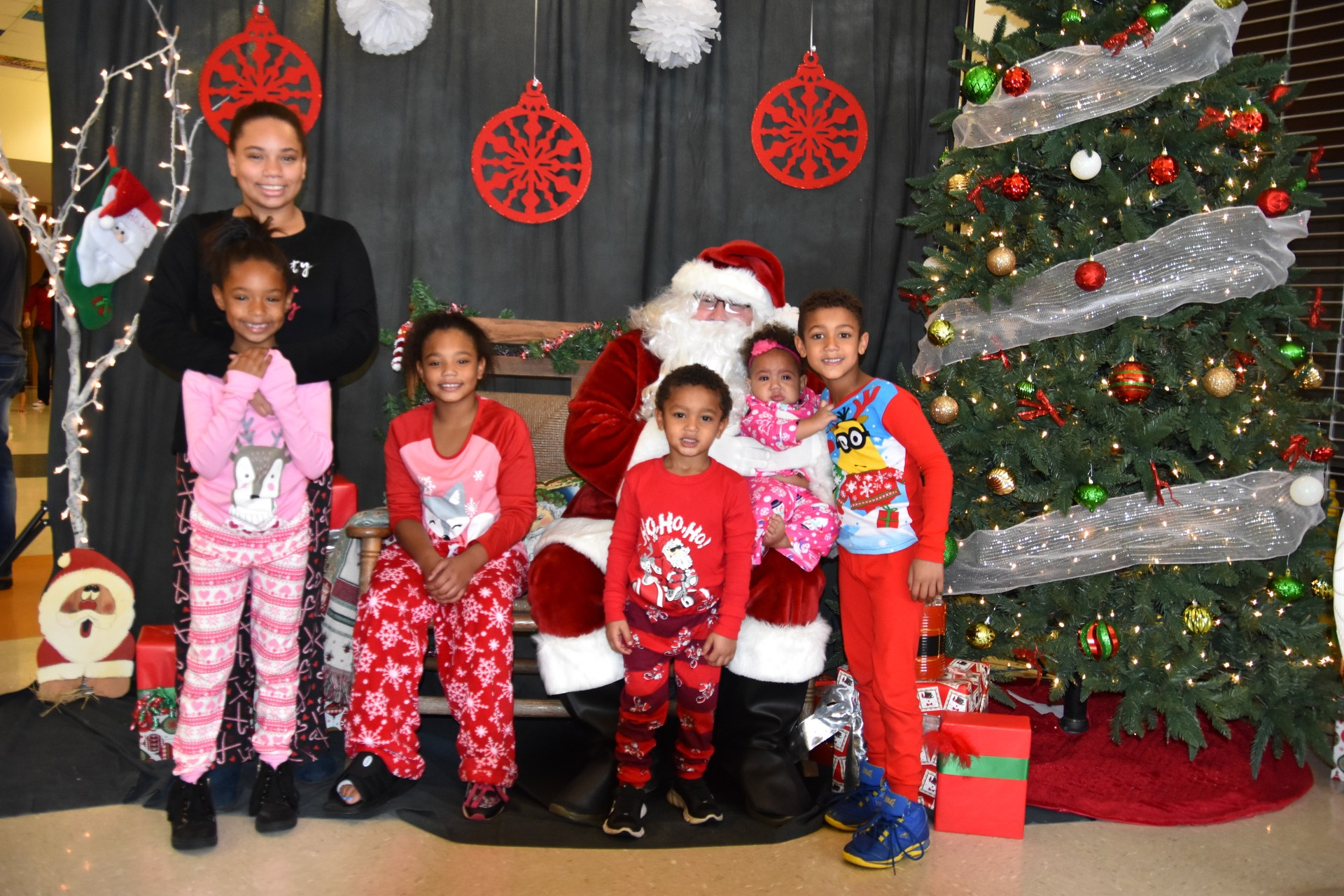 Kids get their pictures taken with Santa during Pancakes with Santa.