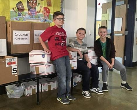 Students who helped package snacks for Soldiers