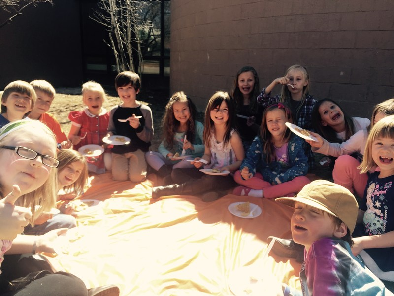 Students eating pie on PI day